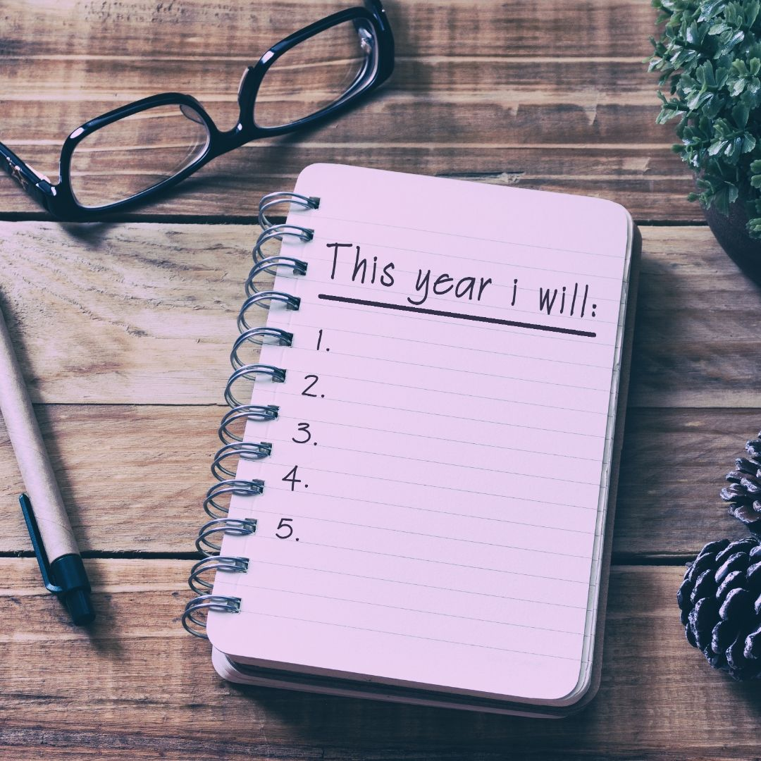 New Year's resolutions for your business. A desk with a blank notepad lying on it.